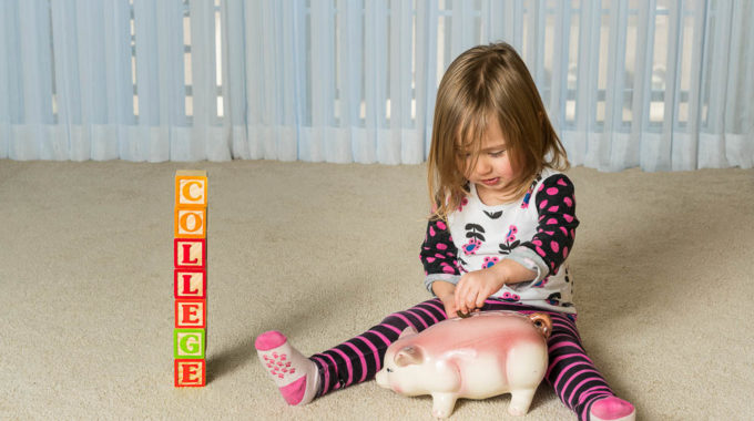 Young Girl On Floor Of Home Saving Money